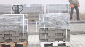Unloading of paving slabs stock footage