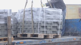 Unloading of paving slabs. Close up stock video