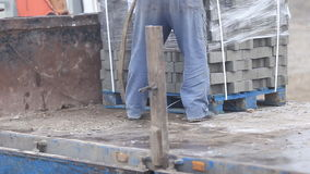 Unloading of paving slabs. Close up stock video footage