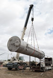 Unloading of processing equipment by means of the crane Stock Photography
