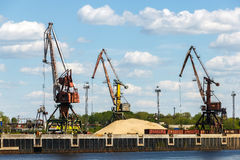 Unloading of railway wagons with sand for Bor glass plant. Port cranes on the bank of Volga River near the Bor town of Nizhny Novgorod region Stock Photos