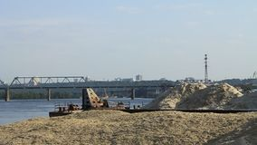 Unloading of sand. Floating crane on the river stock footage