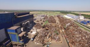 Unloading scrap metal. Unloading of scrap metal factory, view from above, cover shot, camera is flying from right to left stock footage