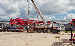 Unloading sections of the boom of a large crawler crane using a Stock Photos
