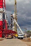 Unloading sections of the boom of a large crawler crane using a Royalty Free Stock Images