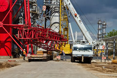 Unloading sections of the boom of a large crawler crane using a Royalty Free Stock Photography