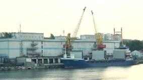 Unloading ship in the seaport. Odessa, Ukraine - June 26, 2016: Unloading ship in the seaport stock video footage