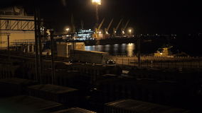 Unloading sulfur in trading seaport at night in Odessa, Ukraine. stock footage