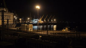 Unloading sulfur in trading seaport at night in Odessa, Ukraine. SEaport in Ukraine at night stock footage