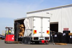 Unloading truck Stock Images
