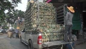 Unloading truck full of pineapples in Bangkok stock video footage
