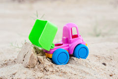 Unloading truck in the sands Stock Image