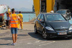 Unloading vehicles from ferry boat in Piombino seaport, Italy Stock Photography