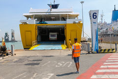 Unloading vehicles from ferry boat in Piombino seaport, Italy Stock Images