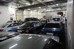 Unloading vehicles on the ferry in the port of Crimea. Royalty Free Stock Photography