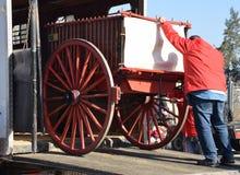 Unloading a wagon. Avoiding uncontrolled sliding on the ramp Royalty Free Stock Photos