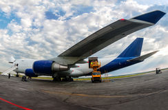 Unloading wide body cargo aircraft. Unloading wide body cargo airplane Royalty Free Stock Photography