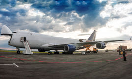 Unloading wide body cargo aircraft. Unloading wide body cargo airplane stock photo