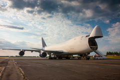 Unloading wide-body cargo airplane. Unloading wide-body cargo aircraft royalty free stock image