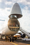 Unloading widebody cargo aircraft. Unloading wide body cargo aircraft royalty free stock image