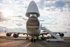 Unloading widebody cargo aircraft. Unloading wide body cargo airplane stock photo