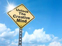 Unlock the creative mind sign. On blue sky background,3d rendered Stock Image