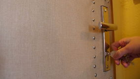 Unlock the Door. A man unlocks the safety lock. Audio is included stock video footage