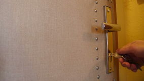 Unlock the Door. A man unlocks the safety lock. Audio is included stock video