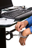 Unlock for the freedom in working. Unlocking the handcuffs that tied the hand to the work desk Royalty Free Stock Images