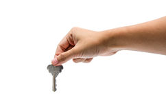 Unlock. A hand holding a metal key Royalty Free Stock Photography