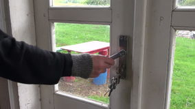 Unlock with key and open farm house door stock footage