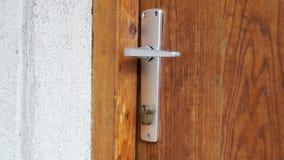 Unlock and open the door. Woman unlock and open the door stock footage