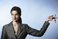Unlock opportunities: woman holding key between fi Royalty Free Stock Photo