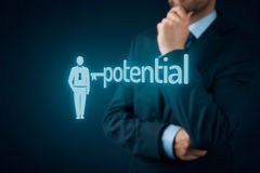 Unlock potential. Motivational concept. Manager (HR specialist) think about motivation - symbol of the key connected with text potential and symbol of the stock images
