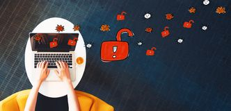 Unlock theme with person using a laptop Stock Image