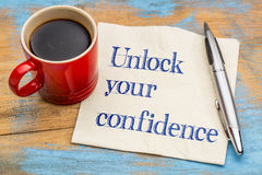 Unlock your confidence advice. Or reminder - handwriting on a napkin with a cup of espresso coffee Stock Photography