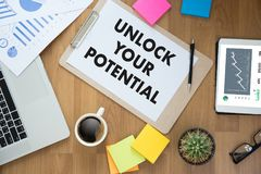 UNLOCK YOUR POTENTIAL  businessman hand working concept for GROW. TH Royalty Free Stock Photo