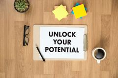 UNLOCK YOUR POTENTIAL  businessman hand working concept for GROW. TH Stock Image