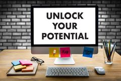 UNLOCK YOUR POTENTIAL  businessman hand working concept for GROW. TH Stock Photo