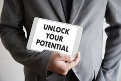 UNLOCK YOUR POTENTIAL  businessman hand working concept for GROW. TH Stock Photos