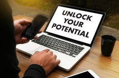 UNLOCK YOUR POTENTIAL  businessman hand working concept for GROW. TH Stock Images