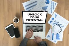 UNLOCK YOUR POTENTIAL  businessman hand working concept for GROW. TH Royalty Free Stock Photos