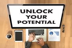 UNLOCK YOUR POTENTIAL  businessman hand working concept for GROW. TH Royalty Free Stock Image