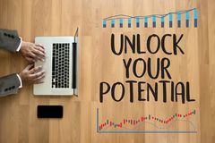 UNLOCK YOUR POTENTIAL  businessman hand working concept for GROW. TH Royalty Free Stock Images