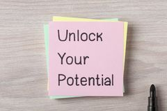 Unlock Your Potential. Handwritten on note. Top view Royalty Free Stock Photo