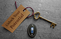 Unlock your potential. Message with gold key stock images