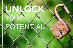Unlock your potential, realize your ideas. Great quality work. On this picture you can see business and social concept motivational quotes on blurred background stock image