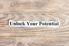 Unlock your potential text on paper. Word unlock your potential on torn paper. Concept Image.  Stock Image