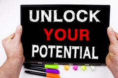 Unlock Your Potential text written on tablet, computer in the office with marker, pen, stationery. Business concept for Self-Devel. Unlock Your Potential text Royalty Free Stock Photo