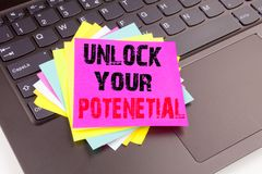 Unlock Your Potential writing text made in the office close-up on laptop computer keyboard. Business concept for Growth on the bla. Ck background with copy space Stock Photo